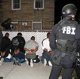 "This photo of FBI agents arresting suspected gang members comes from the FBI's online ""Gang Gallery,"" part of the media hype to convince the public to support more funding for the war on drugs and gangs. Tell your House and Senate representatives to remove those funds from the stimulus package. – Photo: FBI"