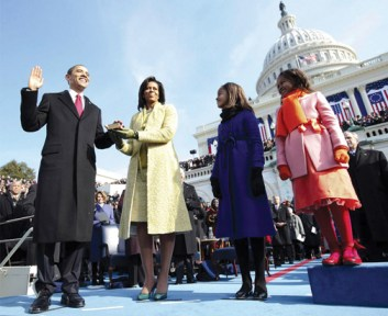 The new First Family beams as Barack Obama is sworn in as the 44th president of the United States. The swearing-in was later repeated because Chief Justice John Roberts flubbed one of the words.  Photo: Chuck Kennedy, Getty Images