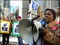 Rallying the crowd at a Charlotte, N.C., Bank of America, Nedra Rollins spoke in solidarity with Chicago workers' sit-down strike. Solidarity rallies have been held across the country, from San Francisco to Charlotte. – Photo: D. Hinshaw, Charlotte Observer