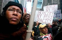 "Hundreds protested Friday for the second time in as many days outside New York Post headquarters, shouting, ""Boycott the Post! Shut it down!"" and ""End racism now!"" ""Since when can you call for the killing of the president of the United States?"" demanded City Councilman Charles Barron. – Photo: Mario Tama, AFP Getty Images"