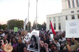 Clearly, Oakland's anger will not easily be appeased. Here, the crowd of thousands, outraged at the police murder of Oscar Grant, has marched on Jan. 14 from City Hall to the Alameda County Courthouse, where District Attorney Tom Orloff is headquartered. – Photo: Dave Id, IndyBay