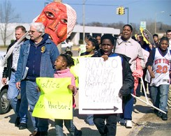Supporters from across Michigan rally and march for Rev. Pinkney in Benton Harbor, May 14, 2007. Rev. Pinkney is being persecuted mainly by Whirlpool for opposing its land grab of the Black town's valuable lakefront park. The huge corporation acts as if it owns Benton Harbor and its people.