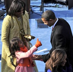 Sasha Obama gives dad the thumbs up after he takes the oath of office. – Photo: PA