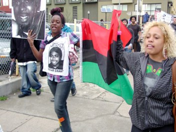 The latest march for Oscar Grant, the March for Stolen Lives on Friday, Feb. 6, also honored all those whose loved ones have been killed by police. During the march, former BART cop Johannes Mehserle, the trigger man who murdered Oscar Grant, was bailed out of jail. – Photo: Dave Id, Indybay