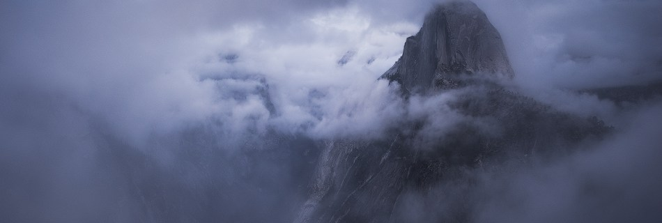 A photo of Half Dome and the valley in the clouds, taken at Yosemite National Park, California