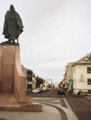 "This statue of Leif Eriksson looks out over Reykjavík. The text on the monument reads: Leifr Eiricsson Son of Iceland Discoverer of Vinland The United States of America to the People of Iceland on the one thousandth anniversary of the Althing AD 1930 I guess whoever carved it wasn't really into the whole ""punctuation"" fad yet. The Althing was the first parliamentary organization in the modern world."