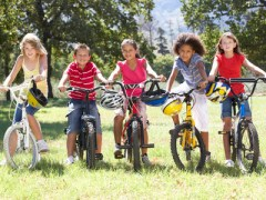41460090 - group of children riding bikes in countryside