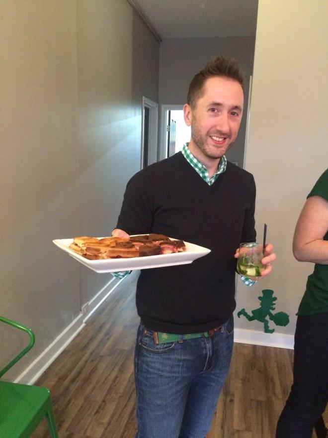 Shaun serving Rueben sandwiches