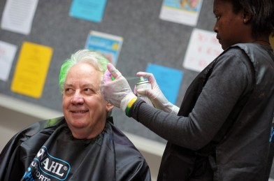 UCT Prof John Simpson of the School of Management Studies has his hair coloured by Emilia Delfin