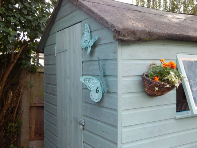 Metal Butterflies on shed