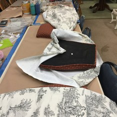 applying the Toile fabric to the chair seats
