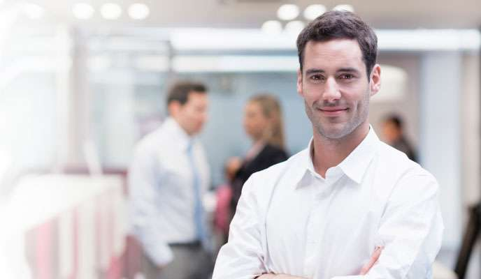 Business man in office wearing white shirt