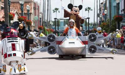"""""""Jedi Mickey Mouse"""" leads a """"Star Wars"""" parade May 21, 2010 during the grand opening festivities of """"Star Wars Weekends"""" at Disney's Hollywood Studios in Lake Buena Vista, Fla.  May 21, 2010 also marks the 30th anniversary of the U.S. premiere of """"The Empire Strikes Back,"""" the second film in the """"Star Wars"""" series.  This year, """"Star Wars Weekends"""" is celebrating the 30th anniversary of the film.  (AP Photo/Disney, Matt Stroshane)"""