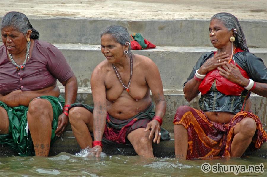 village girl bathing in river
