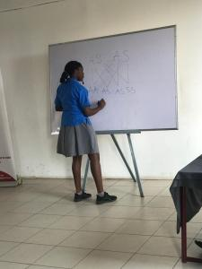 A student of Alpha Beta demonstrating her knowledge of Sickle Cell inheritance by calculating the probability of passing on the disease to offspring based on parental genotypes.