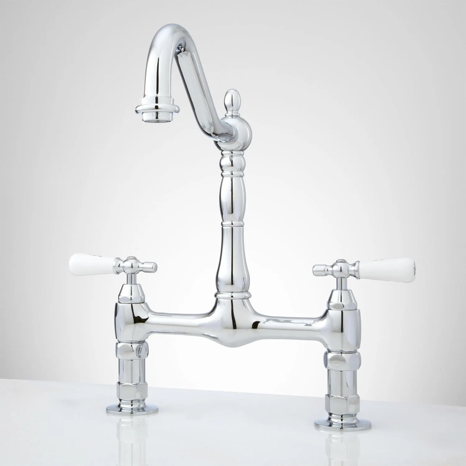 douglass bridge kitchen faucet with porcelain lever handles kitchen faucets The Douglass Bridge Kitchen Faucet features porcelain lever handles and a swivel spout that allows for more room when washing pans