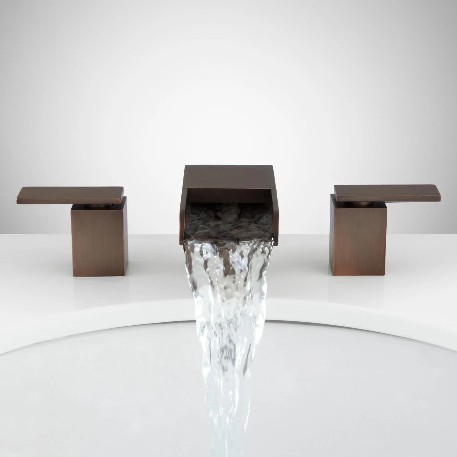 Willis widespread waterfall faucetsleek rectangular shaping and a waterfall spout make the willis widespread bathroom faucet a brilliant addition