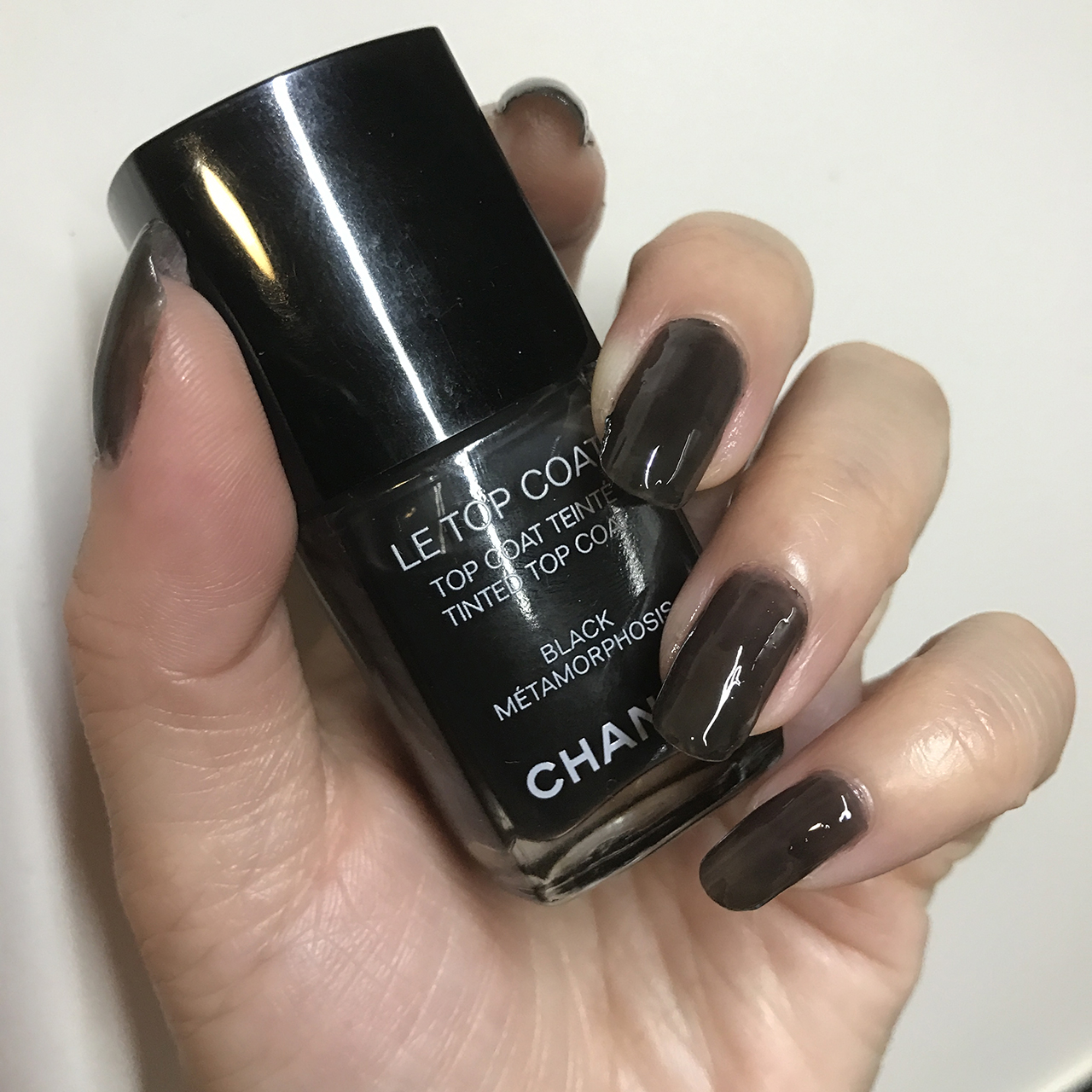 Chanel Le Top Coat Black Metamorphosis nail swatch