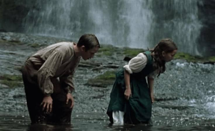 Young John Ridd and young Lorna Doona. John is teaching Lorna how to catch a fish with her hands.