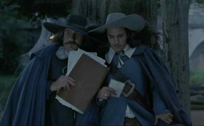 Cyrano and Christian hide from Roxanne in Cyrano de Bergerac