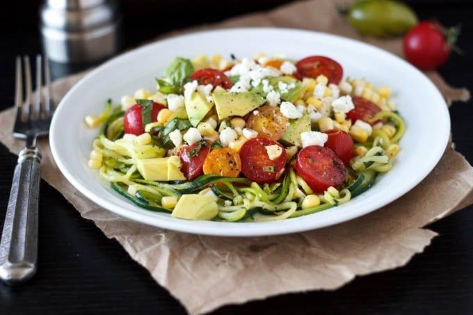 zucchini pasta with tomatoes feta corn avocado