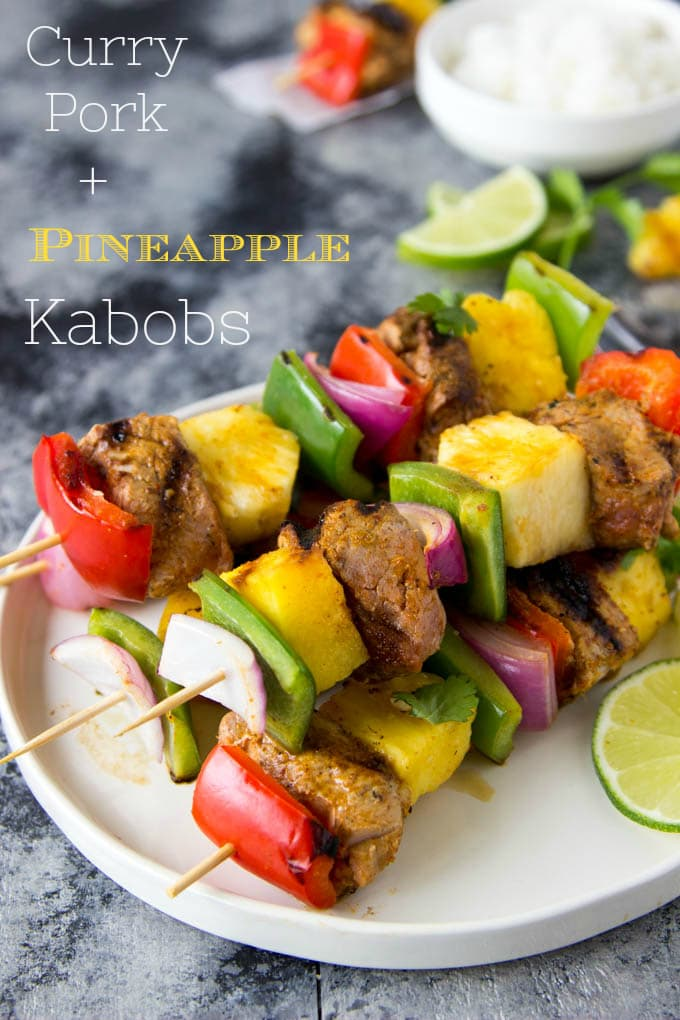 Curry Pork + Pineapple Kabobs- The perfect combination of savory and sweet! You can whip up these nutritious skewers of juicy curry marinated pork, red and green bell peppers, onions and sweet juicy pineapple in just a few minutes. Fire up the BBQ or cook them indoors on the stove-top or in the oven