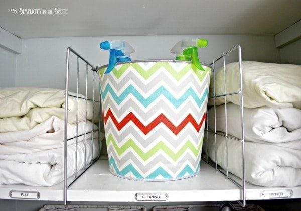 decoupaged fabric on a galvanized bin