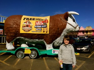 My sweet boy! His eyes are closed because he is embarrassed to stand in front of the big bull. I thought it was because of the sun.