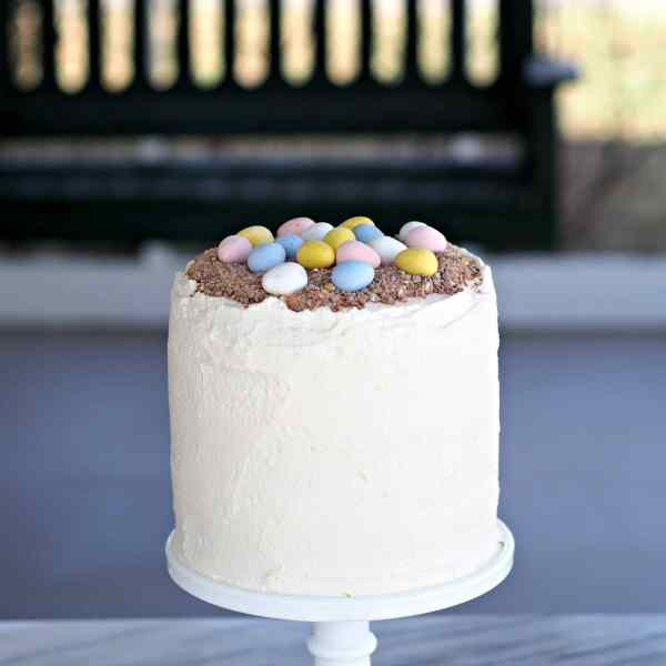 Cadbury Mini Eggs Cake with Mascarpone Whipped Cream. Layers of white cake married with Mascarpone Whipped Cream Frosting mixed w/crushed Cadbury Mini Eggs. Simply