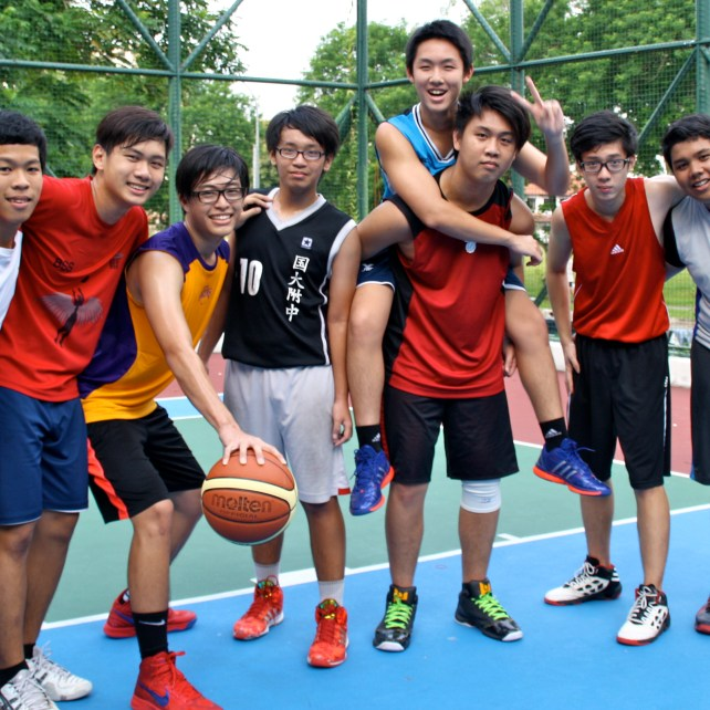 Young singaporeans (and supposedly future NBA stars) playing basketball.