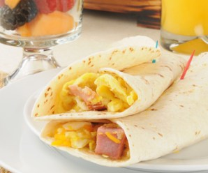 Ham and egg burrito with fruit cocktail for breakfast
