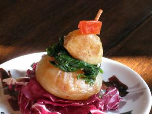 cipolline onion and roasted garlic stacked appetizer with radicchio
