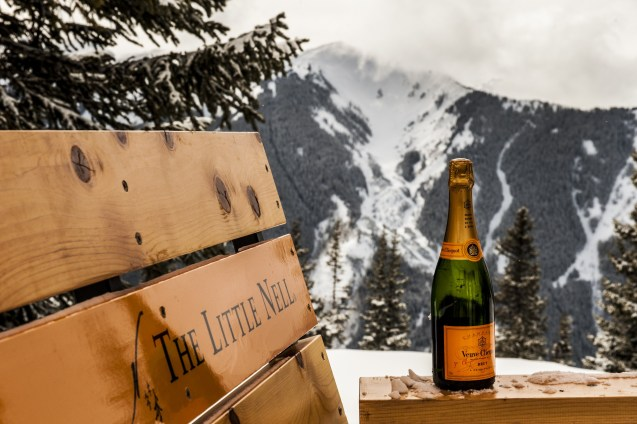 Enjoy a bottle of Vueve Clichot and epic mountain views at Aspen's Oasis traveling champagne bar. pc: Aspen/Snowmass