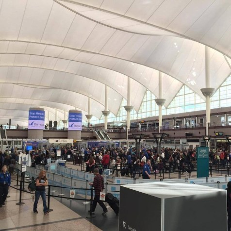Navigating busy airports with oversized ski or board bags is not a great way to kick off your vacation. | Photo: Denver International Airport