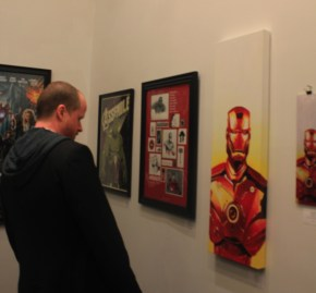 Joss Whedon looking at art at the 'Avengers Assemble' Art Show