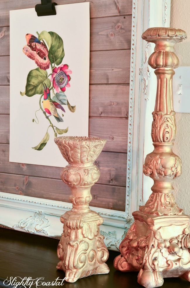 This French Country Chalk Painted Frame Art Display was a thrift store frame painted and distressed with a wet cloth. Then tongue and groove boards stained grey were added to the back to make a fun and changeable way to display art. See it all on Slightly Coastal.