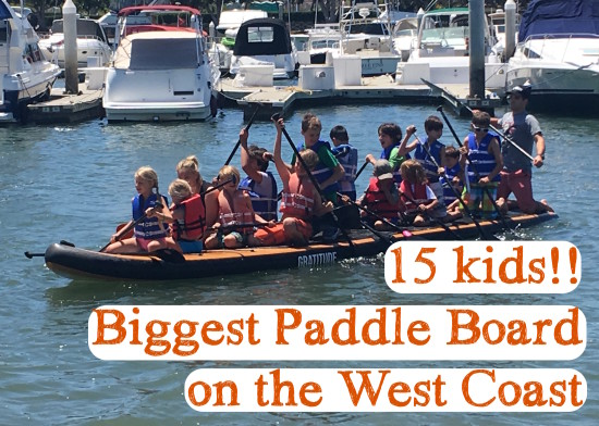 kids on biggest paddle board on the west coast