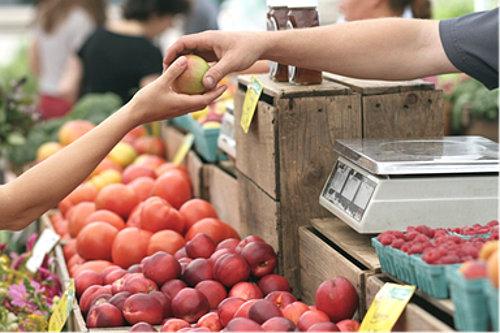 Seller and customer at market
