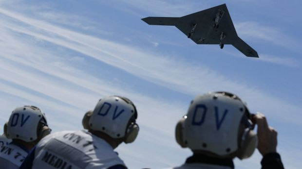 An X-47B pilot-less drone combat aircraft is launched for the first time off an aircraft carrier, the USS George H. W. Bush, in 2013.