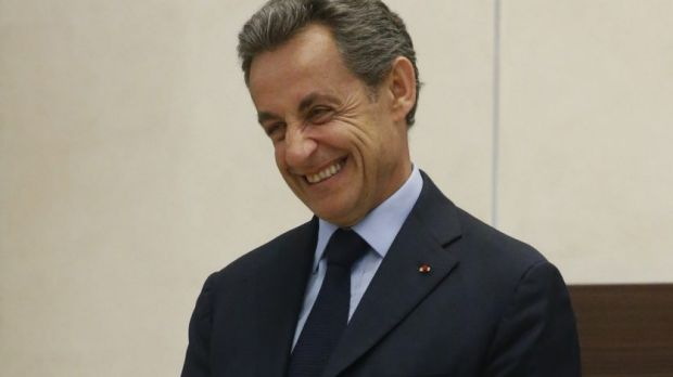 Former French president Nicolas Sarkozy waits for a meeting with Russian President Vladimir Putin.