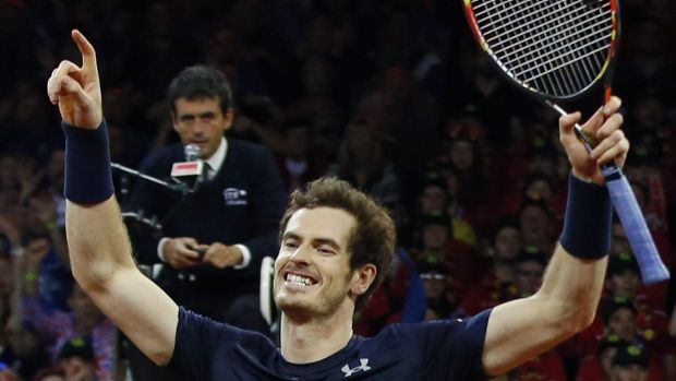 Britain?s Andy Murray celebrates winning the doubles Davis Cup final tennis match with his brother Jamie in four sets, 4-6, 6-4, 6-3, 6-2, against Belgium?s Steve Darcis and David Goffin at the Flanders Expo in Ghent, Belgium, Saturday, Nov. 28, 2015. (AP Photo/Alastair Grant)