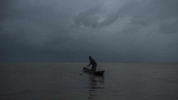 Byron Presida fishes from a dugout canoe off the shore of Bangkukuk Taik, Nicaragua, a remote village home to the Rama ...