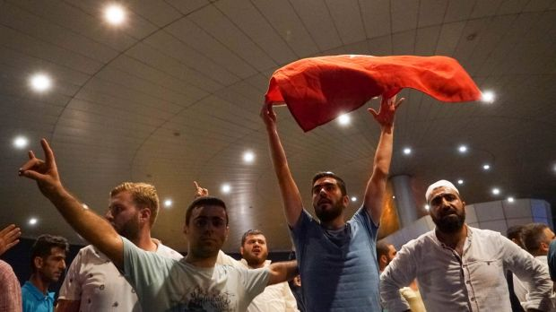 Supporters of President Erdogan chant slogans at Ataturk Airport on in Istanbul on Saturday.