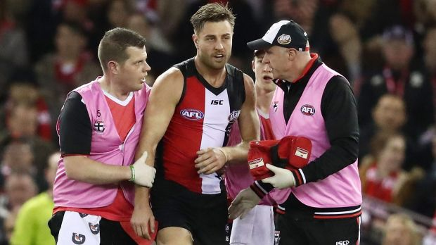 Future in doubt: Sam Fisher is escorted from the field after being hit by Toby Nankervis.