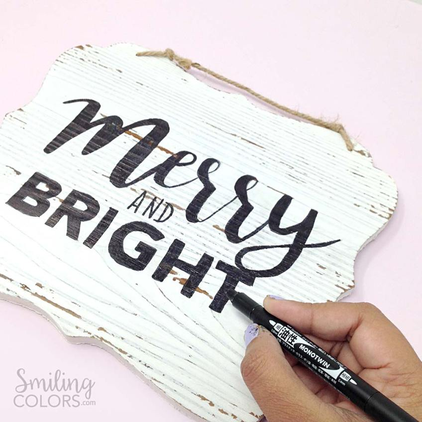 DIY hand lettered wood sign with a pen marker tombow