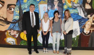 Smithtown High School East Principal Edwin Thompson, with students Emily Knott, Leesa Peterson and their art teacher, Dianne Shanian  Photo courtesy of Smithtown Central School District