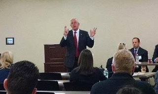 Comptroller Kennedy speaking before attendees at the TFCUniversity Business Clinic