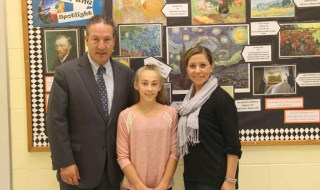 Left to right: Dr. Izzet Mergen, Director of Fine and Performing Arts, Kathryn Fligstein, student contest winner, and Ms. Kara LiCausi, Northport Middle School Art Teacher. Photo courtesy of Northport-East Northport Schools