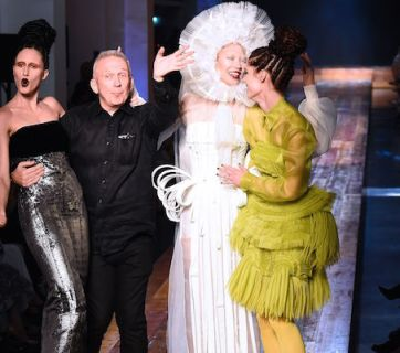 US model Anna Cleveland (L), French fashion designer Jean Paul Gaultier (2nd L) and Canadian model Coco Rocha (R) acknowledge the audience at the end of the 2016-2017 fall/winter Haute Couture collection fashion show on July 6, 2016 in Paris. / AFP / BERTRAND GUAY        (Photo credit should read BERTRAND GUAY/AFP/Getty Images)