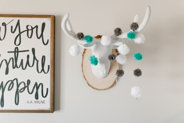 Caleb's Rustic Neutral Nursery Reveal With White, Gray, and Wood Accents Faux Deer Heads With Pom Pom Garland Closeup